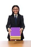 El hombre de negocios que sostiene los cuadernos aislados en blanco Imagen de archivo libre de regalías