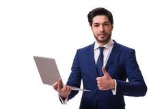 El hombre de negocios que trabaja con el ordenador portátil aislado en blanco fotos de archivo