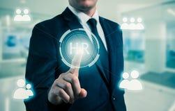 El hombre de negocios señala a la icono-hora, al reclutamiento y al concepto elegido Fotografía de archivo libre de regalías