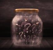 El hombre de negocios se cerró en un tarro con concepto de los signos de interrogación Imagen de archivo libre de regalías