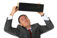 El hombre de negocios se protege con la maleta Foto de archivo libre de regalías