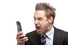 El hombre de negocios tiene tensión en el teléfono móvil fotografía de archivo libre de regalías
