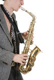 El hombre del jazz toca un saxofón Imagen de archivo libre de regalías