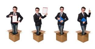 El hombre divertido con las cajas aisladas en blanco Fotografía de archivo libre de regalías