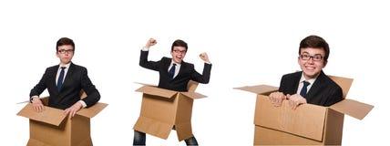 El hombre divertido con las cajas aisladas en blanco Imágenes de archivo libres de regalías