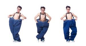 El hombre divertido con los pantalones aislados en blanco imágenes de archivo libres de regalías