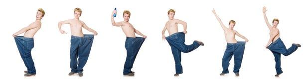 El hombre divertido con los pantalones aislados en blanco Imagen de archivo