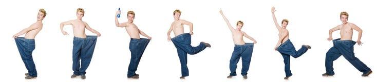 El hombre divertido con los pantalones aislados en blanco Fotografía de archivo
