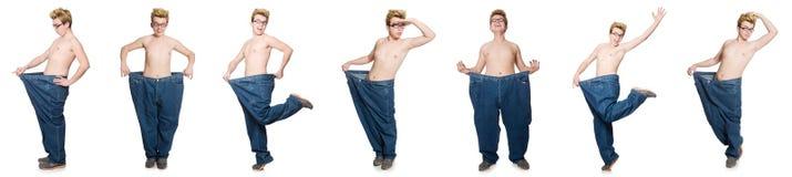 El hombre divertido con los pantalones aislados en blanco Fotos de archivo libres de regalías