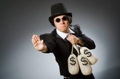 El hombre divertido con los sacos del dólar imágenes de archivo libres de regalías