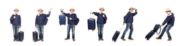 El hombre divertido con el sombrero del safari del equipaje que lleva foto de archivo libre de regalías