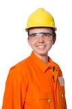El hombre en batas anaranjadas en blanco Imágenes de archivo libres de regalías