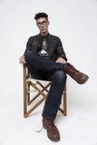 El hombre en la silla del ` s del director Fotografía de archivo