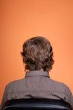 El hombre en una butaca una parte posterior fotos de archivo libres de regalías