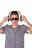 El hombre está escuchando la música Fotografía de archivo