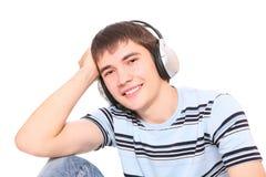 El hombre está escuchando la música Imagen de archivo libre de regalías