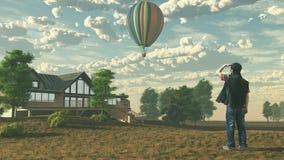El hombre está mirando el globo del aire caliente Imagenes de archivo
