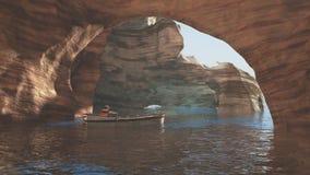 El hombre está navegando en la cueva del mar Fotografía de archivo libre de regalías