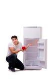 El hombre hambriento que busca el dinero para llenar el refrigerador Fotografía de archivo libre de regalías