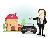 El hombre indica sus manos en la casa y el coche Fotos de archivo