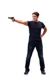El hombre joven agresivo con el arma aislado en blanco Foto de archivo libre de regalías