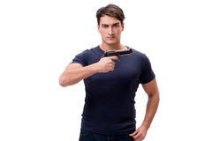 El hombre joven agresivo con el arma aislado en blanco Imagen de archivo libre de regalías