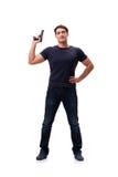 El hombre joven agresivo con el arma aislado en blanco Fotografía de archivo libre de regalías