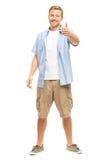 El hombre joven atractivo manosea con los dedos encima de integral en el fondo blanco Fotografía de archivo