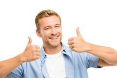 El hombre joven atractivo manosea con los dedos encima de integral en el fondo blanco Foto de archivo libre de regalías