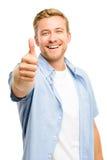 El hombre joven atractivo manosea con los dedos encima de integral en el fondo blanco Fotos de archivo libres de regalías