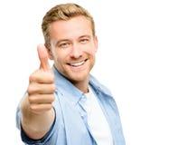 El hombre joven atractivo manosea con los dedos encima de integral en el fondo blanco Imagen de archivo libre de regalías