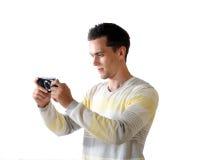 El hombre joven con el adminículo Imagen de archivo libre de regalías