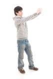 El hombre joven con la cámara aislada en un blanco Fotos de archivo