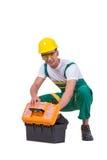El hombre joven con la caja de herramientas del juego de herramientas aislada en blanco Foto de archivo libre de regalías