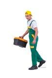 El hombre joven con la caja de herramientas del juego de herramientas aislada en blanco Imagen de archivo