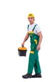 El hombre joven con la caja de herramientas del juego de herramientas aislada en blanco Fotos de archivo