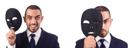 El hombre joven con la máscara negra aislada en blanco foto de archivo libre de regalías