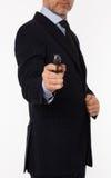 El hombre joven con una pistola Imagenes de archivo