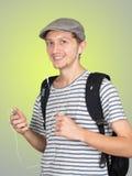 El hombre joven escucha música Imagen de archivo