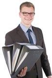 El hombre joven está sosteniendo varios ficheros Fotos de archivo