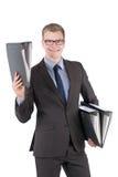 El hombre joven está sosteniendo varios ficheros Imágenes de archivo libres de regalías