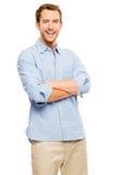 El hombre joven feliz arma la sonrisa doblada en el fondo blanco Fotografía de archivo libre de regalías