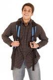 El hombre joven hermoso con el frente sonriente de la mochila compite Foto de archivo