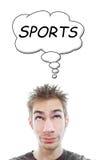 El hombre joven piensa deportes Foto de archivo libre de regalías