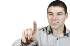 El hombre joven puso su dedo al vidrio Imágenes de archivo libres de regalías