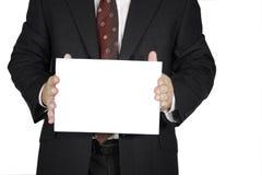 El hombre lleva a cabo el cartel Fotografía de archivo