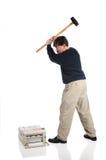 El hombre martilla la impresora Fotografía de archivo