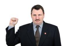 El hombre melancólico muestra el gesto de los comunistas de la solidaridad Imágenes de archivo libres de regalías