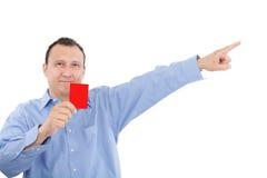El hombre muestra a alguien una tarjeta roja Fotografía de archivo libre de regalías