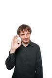 El hombre muestra una mano de la autorización de la muestra Imágenes de archivo libres de regalías